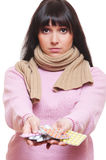Sad woman holding pills Royalty Free Stock Photos
