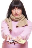 Sad woman holding pills royalty free stock photos
