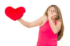 Sad woman holding red valentine heart Stock Images
