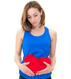 Sad woman holding red valentine heart Royalty Free Stock Image