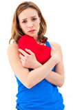 Sad woman holding red valentine heart Royalty Free Stock Photography
