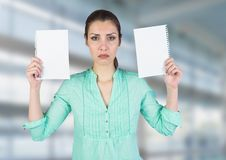 Sad woman holding ripped apart paper against blurred blue background Stock Photos