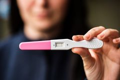 Sad woman with home pregnancy test Royalty Free Stock Image