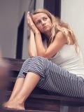 Sad woman at home royalty free stock photo