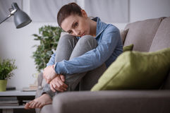 Sad woman at home royalty free stock images