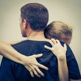 Sad woman hugging her husband Stock Photos