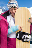 Sad woman with injured arm Stock Photo