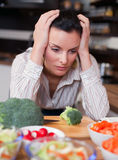 Sad woman in kitchen Stock Photos