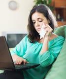 Sad woman with laptop Stock Photo