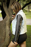 Sad woman. Latin woman standing beside a tree with a sad expression Stock Photography