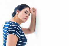 Sad woman leaning against the wall Royalty Free Stock Photo