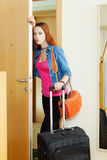 Sad woman leaving  home Stock Photography