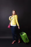 Sad woman leaving with a luggage Stock Photography
