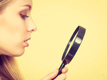 Sad woman looking at damaged hair ends. Royalty Free Stock Images