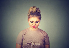 Sad woman looking down Royalty Free Stock Photography