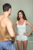 Sad woman looking at man Stock Images