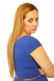 Sad woman looking over shoulder Royalty Free Stock Image