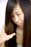 Sad woman looking split ends hair Stock Images