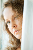 Sad woman looking through the window Royalty Free Stock Image