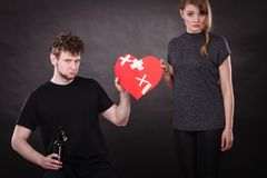 Sad woman and man addicted to alcohol. Broken heart. Unhappy couple. Family and alcoholism problems. Addiction and trouble of drinking. Man with alcohol bottle stock photography