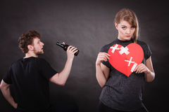 Sad woman and man addicted to alcohol. Broken heart. Royalty Free Stock Photography