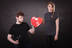 Sad woman and man addicted to alcohol. Broken heart. Unhappy couple. Family and alcoholism problems. Addiction and trouble of drinking. Man with alcohol bottle royalty free stock photography