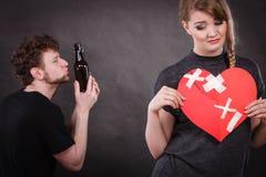 Sad woman and man addicted to alcohol. Broken heart. Stock Photography