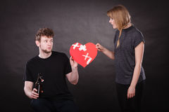 Sad woman and man addicted to alcohol. Broken heart. Stock Image