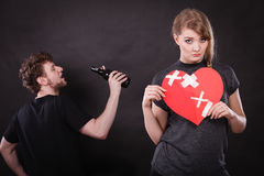 Sad woman and man addicted to alcohol. Broken heart. Unhappy couple. Family and alcoholism problems. Addiction and trouble of drinking. Man with alcohol bottle royalty free stock images