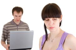 Sad woman and man with laptop Royalty Free Stock Photo