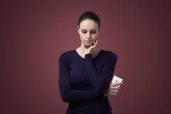 Sad woman with mobile phone Stock Photos