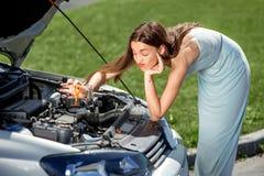 Sad woman near the broken car Royalty Free Stock Images