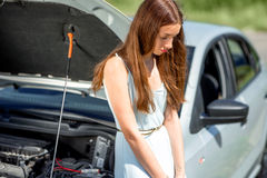 Sad woman near the broken car Royalty Free Stock Photos