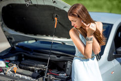 Sad woman near the broken car Royalty Free Stock Image