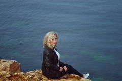 Sad woman near the sea Stock Photography