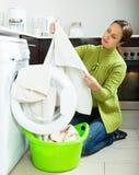 Sad woman near washing machine Stock Photography