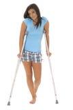 Sad Woman On Crutches Stock Photo