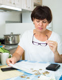 Sad woman paying bills Stock Photos