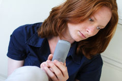 Sad woman with a phone Royalty Free Stock Photography