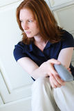 A Sad Woman with a Phone Royalty Free Stock Images