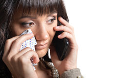 Sad woman with phone Stock Photography