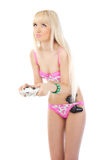 Sad woman in pink lingerie with game joystic Stock Photography