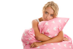 Sad woman with pink pillow Royalty Free Stock Images