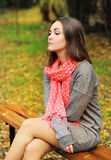Sad woman portrait sitting on a bench. Stock Photo
