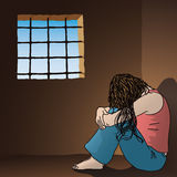 Sad woman in prison. A sad and hopeless woman sitting in a small prison cell Royalty Free Stock Photos