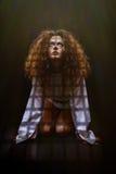 Sad woman prisoner Royalty Free Stock Images