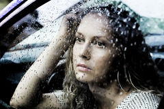 Sad woman and a rain Royalty Free Stock Photography