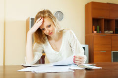 Sad woman reading financial documents Stock Photos