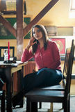 Sad woman in a restaurant Stock Image