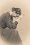 Sad woman retro style portrait. Long dark gown, vintage photo sepia toned stock images